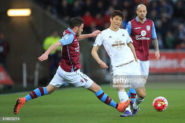 Ki SungYeung of Swansea City and Jordan Veretout of Aston Villa compete for the ball during the Barclays Premier League match between Swansea City...