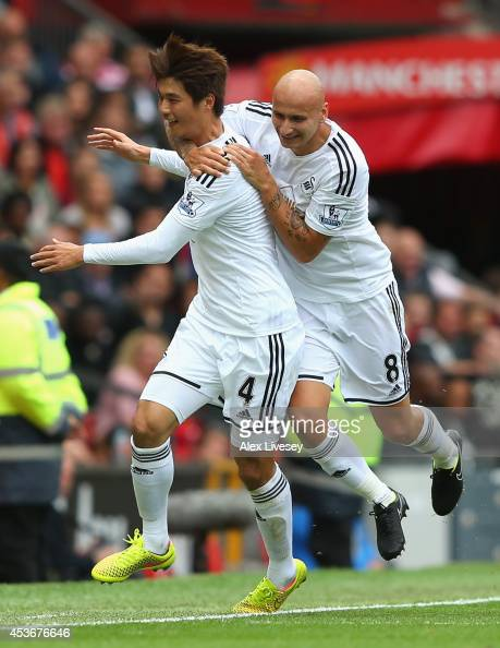 Ki SungYeung of Swansea City celebrates scoring the opening goal with his teammate Jonjo Shelvey during the Barclays Premier League match between...