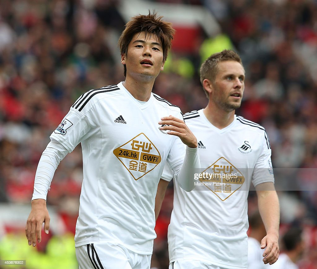 Ki SungYeung of Swansea City celebrates scoring their first goal during the Barclays Premier League match between Manchester United and Swansea City...