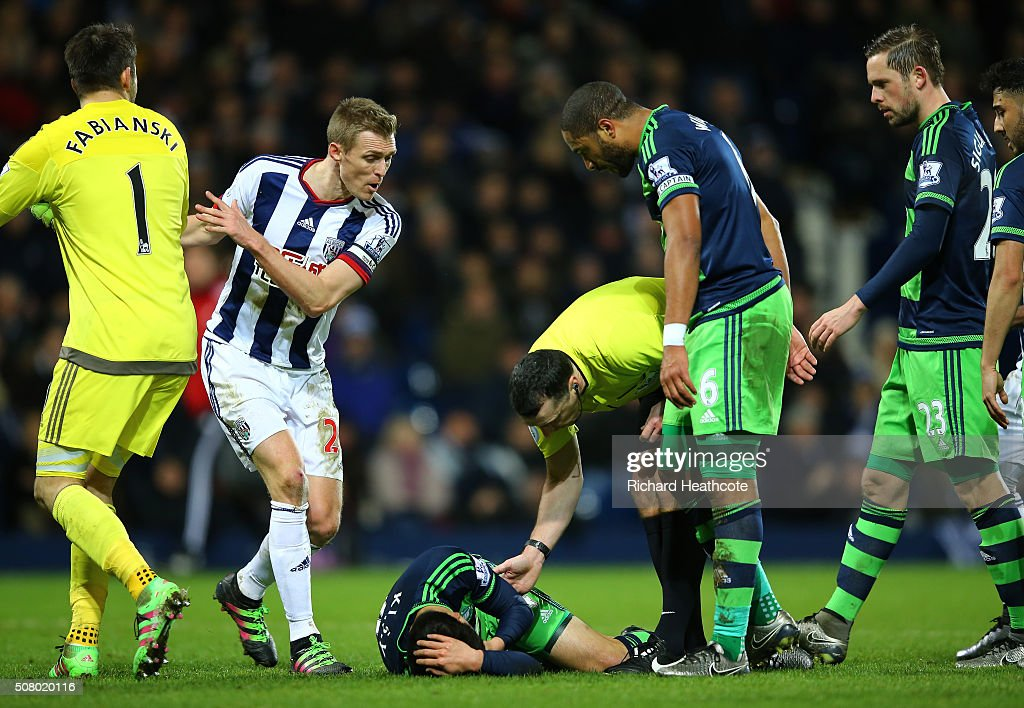Ki SungYeung of Swansea City lies injured during the Barclays Premier League match between West Bromwich Albion and Swansea City at The Hawthorns on...