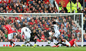 Ki SungYeung of Swansea City scores the opening goal during the Barclays Premier League match between Manchester United and Swansea City at Old...