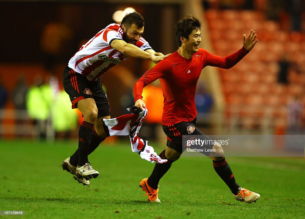Ki SungYong of Sunderland celebrates scoring the winning goal in extra with Andrea Dossena of Sunderland during the Capital One Cup QuarterFinal...