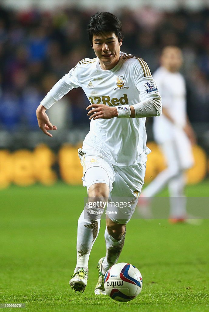 Ki Sung-Yong of Swansea City in action during the Capital One Cup Semi-Final Second Leg match between Swansea City and Chelsea at Liberty Stadium on January 23, 2013 in Swansea, Wales.