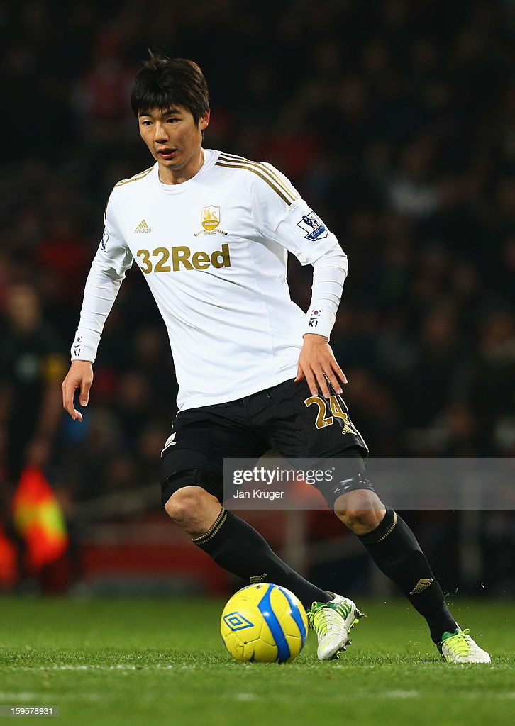 Ki Sung-Yong of Swansea City in action during the FA Cup with Budweiser Third Round Replay match between Arsenal and Swansea City at the Emirates Stadium on January 16, 2013 in London, England.