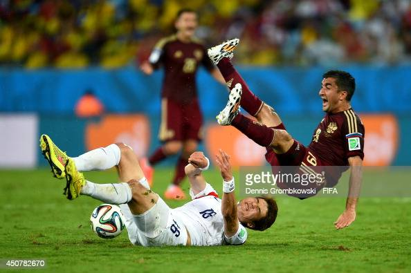 Ki SungYueng of South Korea and Alexander Samedov of Russia clash during the 2014 FIFA World Cup Brazil Group H match between Russia and Korea...