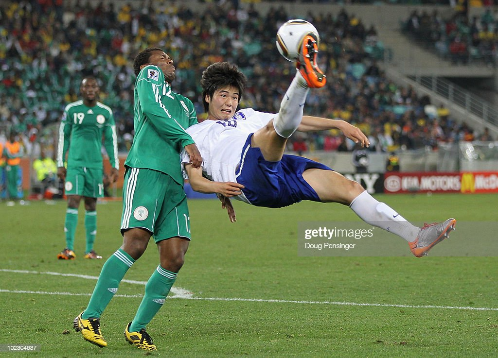 Ki Sung-Yueng of South Korea attempts an overhead kick as <a gi-track='captionPersonalityLinkClicked' href=/galleries/search?phrase=Kalu+Uche&family=editorial&specificpeople=2290697 ng-click='$event.stopPropagation()'>Kalu Uche</a> of Nigeria tries to get out of the way during the 2010 FIFA World Cup South Africa Group B match between Nigeria and South Korea at Durban Stadium on June 22, 2010 in Durban, South Africa.