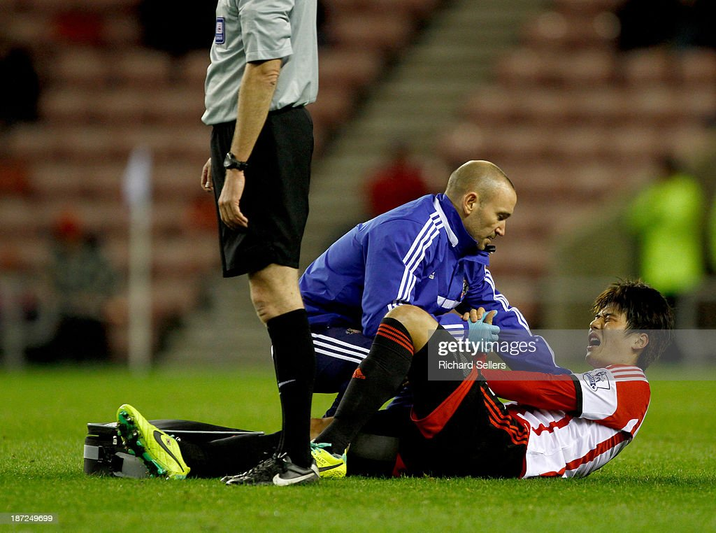 Ki Sung-Yueng of Sunderland receives attention to an injury after a heavy challenge during the Capital One Cup fourth Round match between Sunderland and Southampton at Stadium of Light on November 06, 2013 in Sunderland, England.