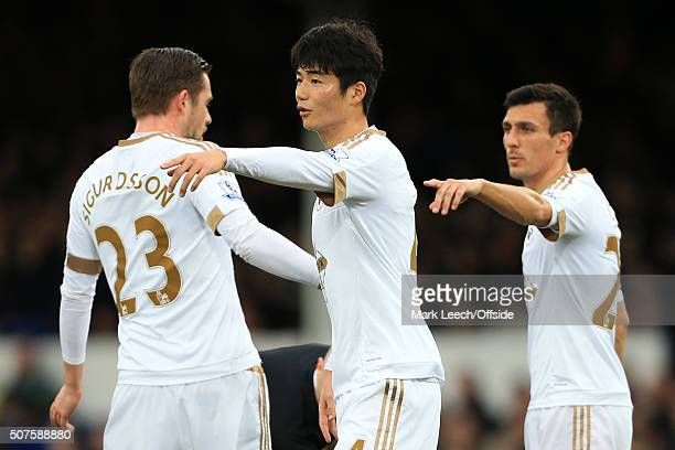 Ki SungYueng of Swansea and Jack Cork of Swansea organise the defensive wall during the Barclays Premier League match between Everton and Swansea...
