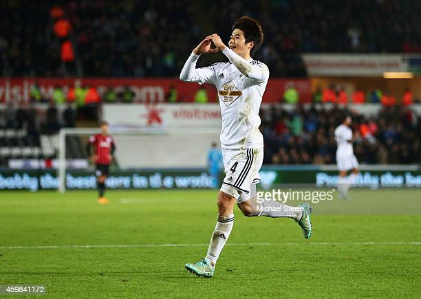 Ki SungYueng of Swansea City celebrates as he scores their first goal during the Barclays Premier League match between Swansea City and Queens Park...