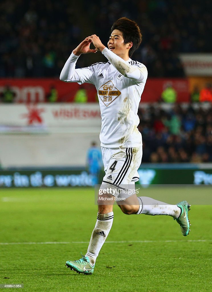 Ki Sung-Yueng of Swansea City celebrates as he scores their first goal during the Barclays Premier League match between Swansea City and Queens Park Rangers at Liberty Stadium on December 2, 2014 in Swansea, Wales.
