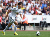 Ki SungYueng of Swansea City in action during a pre season friendly match between Swansea City and Villarreal at Liberty Stadium on August 09 2014 in...