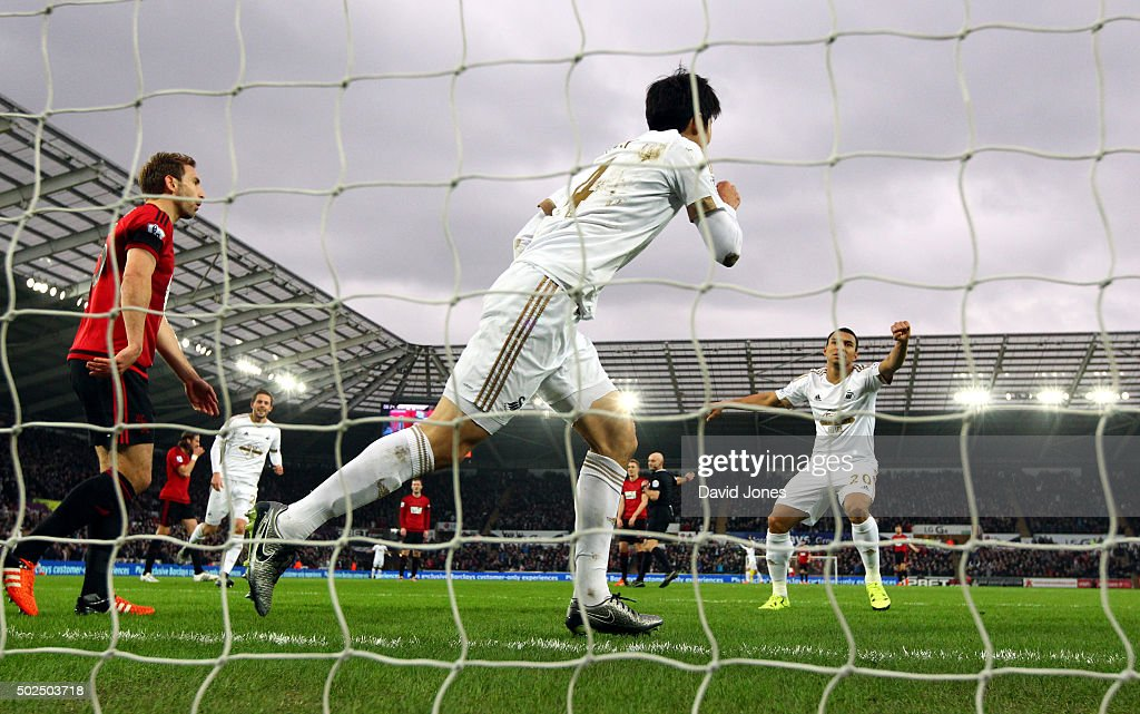 Ki Sung-Yueng of Swansea City scores against West Bromwich Albion during the Barclay's Premier League match between Swansea City v West Bromwich Albion at the Liberty Stadium on December 26, 2015 in Swansea, Wales.