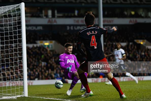 Ki SungYueng of Swansea City shoots past Hugo Lloris of Spurs as he scores their first and equalising goal during the Barclays Premier League match...