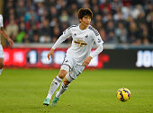 Ki SungYueng of Swansea in action during the Barclays Premier League match between Swansea City and Crystal Palace at Liberty Stadium on November 29...