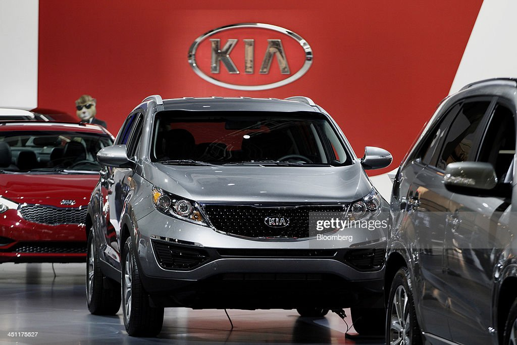 A Kia Motors Corp. Sportage vehicle is displayed during the LA Auto Show in Los Angeles, California, U.S., on Thursday, Nov. 21, 2013. The 2013 LA Auto Show is open to the public Nov. 22 - Dec. 1. Photographer: Jonathan Alcorn/Bloomberg via Getty Images