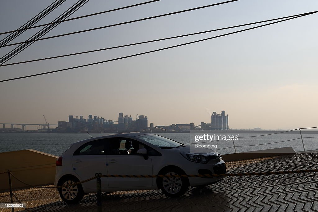 A Kia Motors Corp. vehicle bound for export is driven into a Eukor Car Carriers Inc. roll-on/roll-off (RORO) cargo ship at the port of Pyeongtaek in Pyeongtaek, South Korea, on Monday, Sept. 30, 2013. South Koreas consumer confidence sank to a five-month low in September, even after a rebound in exports fueled the fastest economic growth in two years last quarter. Photographer: SeongJoon Cho/Bloomberg via Getty Images