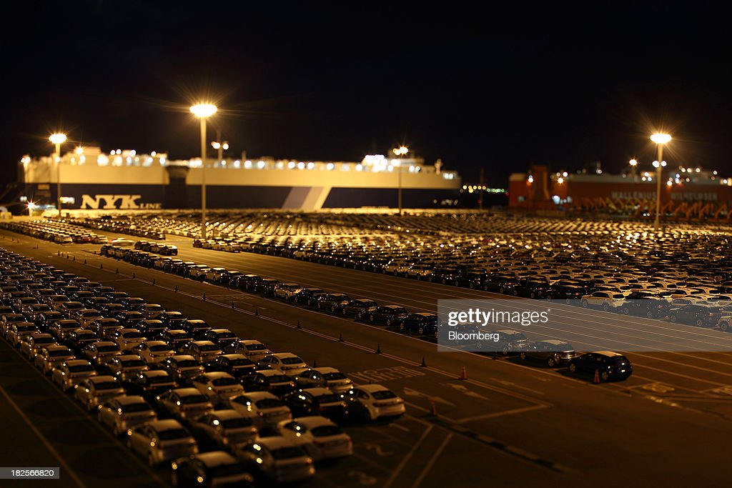 Kia Motors Corp. vehicles bound for export await shipment at night in this photograph taken with a tilt-shift lens at the port of Pyeongtaek in Pyeongtaek, South Korea, on Monday, Sept. 30, 2013. South Koreas consumer confidence sank to a five-month low in September, even after a rebound in exports fueled the fastest economic growth in two years last quarter. Photographer: SeongJoon Cho/Bloomberg via Getty Images
