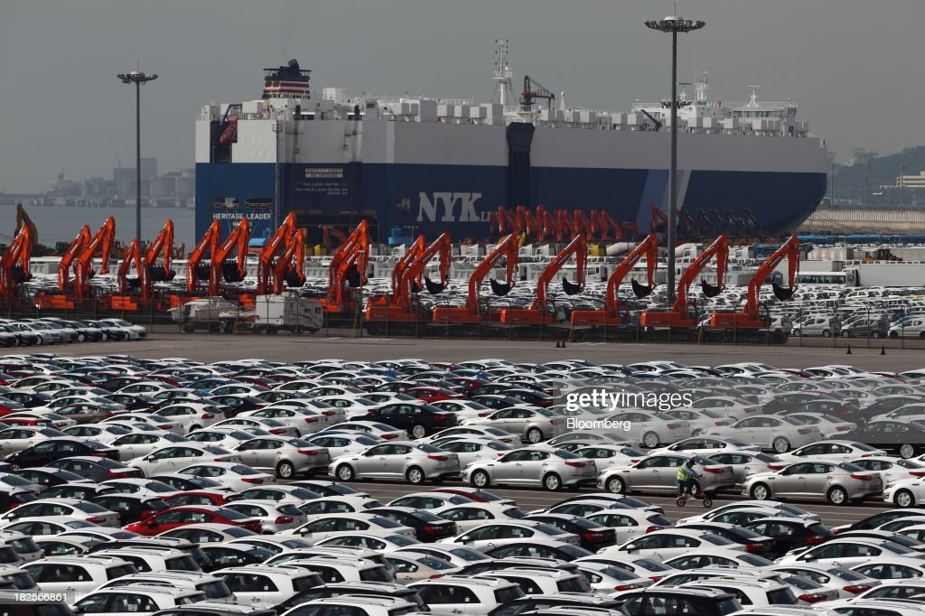 Kia Motors Corp. vehicles bound for export await shipment in front of a Nippon Yusen Kaisha (NYK Line) roll-on/roll-off (RORO) cargo ship at the port of Pyeongtaek in Pyeongtaek, South Korea, on Monday, Sept. 30, 2013. South Koreas consumer confidence sank to a five-month low in September, even after a rebound in exports fueled the fastest economic growth in two years last quarter. Photographer: SeongJoon Cho/Bloomberg via Getty Images