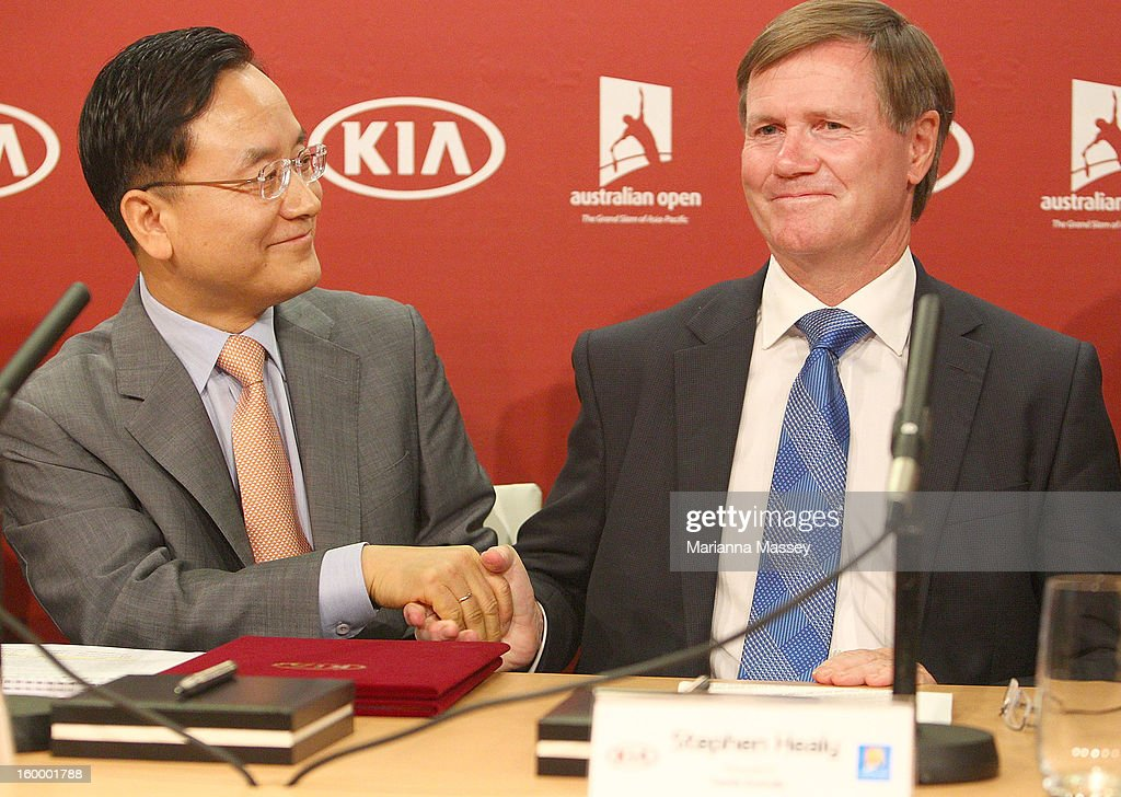 Kia Motors Corporation Senior Executive Vice President and COO Thomas Oh and Tennis Australia President Steve Healy shakes hands after the official signing ceremony for Kia's five-year major sponsorship renewal during day twelve of the 2013 Australian Open at Melbourne Park on January 24, 2013 in Melbourne, Australia.
