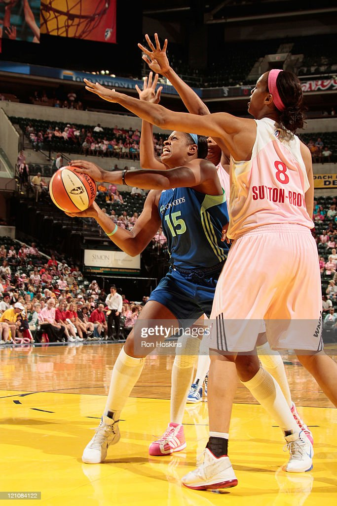 Kia Vaughn of the New York Liberty battles Tammy SuttonBrown of the Indiana Fever at Conseco Fieldhouse on August 13 2011 in Indianapolis Indiana...