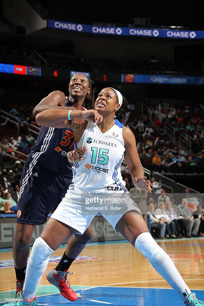 Kia Vaughn of the New York Liberty boxes out against the Connecticut Sun during Game 2 of the Eastern Conference SemiFinals on September 29 2012 at...