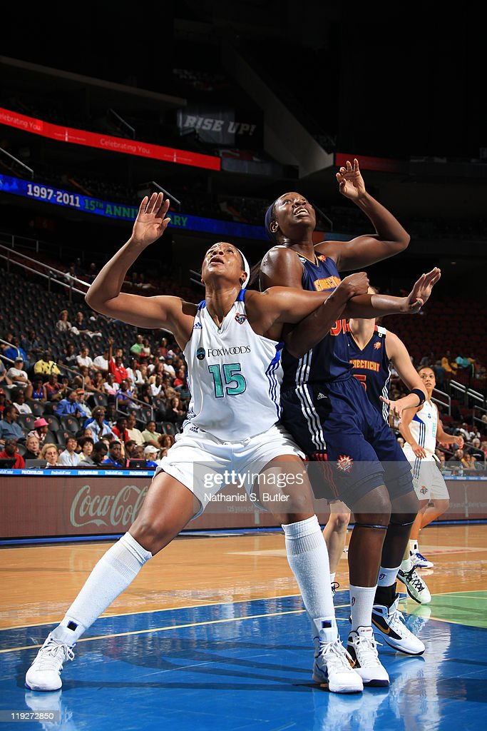 Kia Vaughn of the New York Liberty boxes out against Tina Charles of the Connecticut Sun during a game on July 15 2011 at the Prudential Center in...