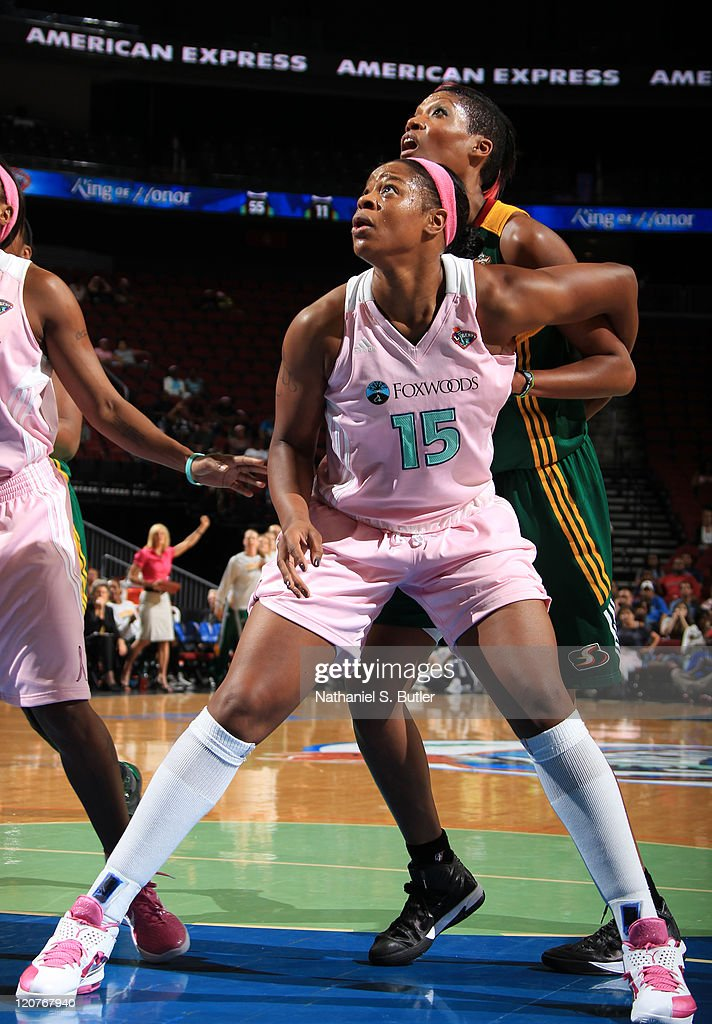 Kia Vaughn of the New York Liberty boxes out Ashley Robinson of the Seattle Storm during a game on August 9 2011 at the Prudential Center in Newark...