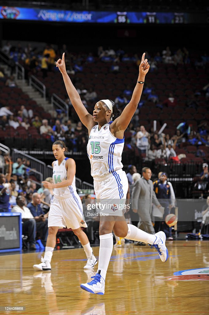 Kia Vaughn of the New York Liberty celebrates a win against the Indiana Fever during the WNBA game on September 9 2011 at the Prudential Center in...