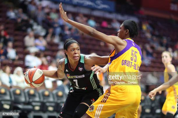 Kia Vaughn of the New York Liberty challenged by Saicha GrantAllen of the Los Angeles Sparks during the Los Angeles Sparks Vs New York Liberty WNBA...