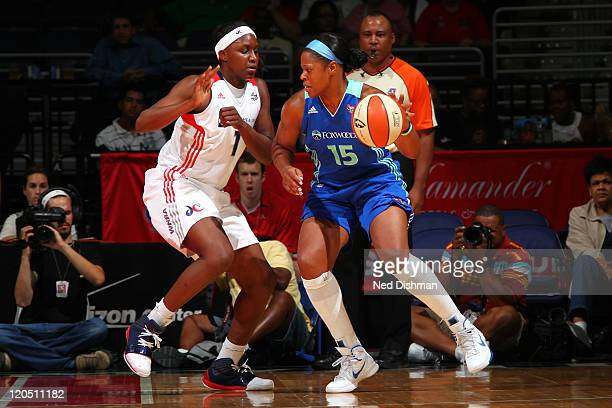 Kia Vaughn of the New York Liberty drives against Crystal Langhorne of the Washington Mystics at the Verizon Center on August 6 2011 in Washington DC...