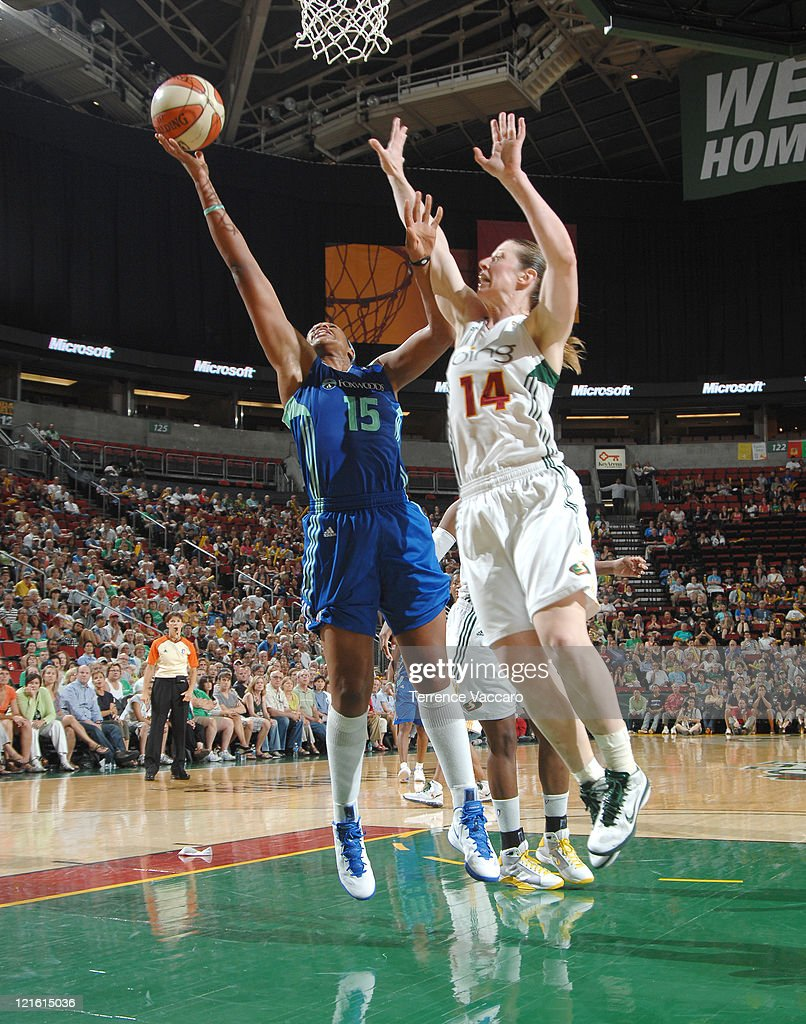 Kia Vaughn of the New York Liberty goes to the basket against Katie Smith of the Seattle Storm during the game on August 20 2011 at Key Arena in...