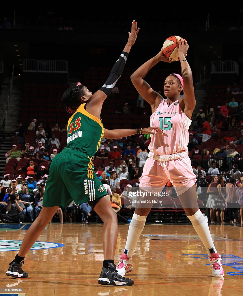 Kia Vaughn of the New York Liberty goes up against Ashley Robinson of the Seattle Storm during a game on August 9 2011 at the Prudential Center in...
