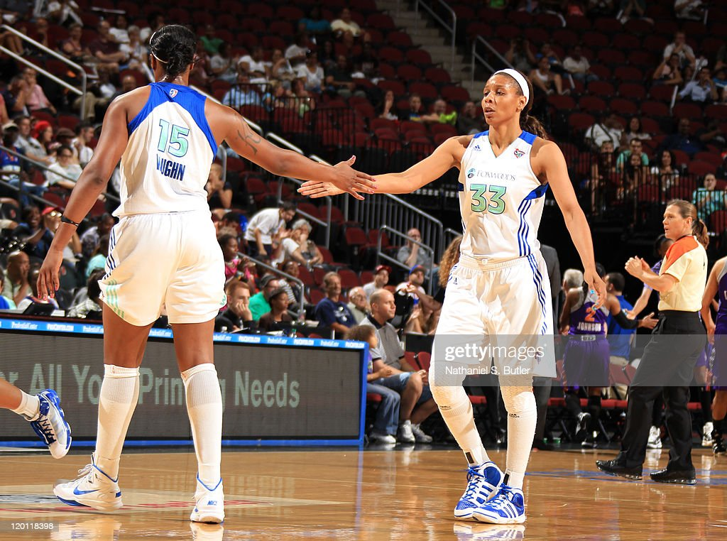 Kia Vaughn of the New York Liberty high fives teammate Plenette Pierson during a game against the Phoenix Mercury on July 30 2011 at the Prudential...