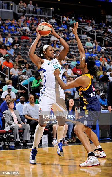 Kia Vaughn of the New York Liberty looks to pass the basketball against Tammy SuttonBrown of the Indiana Fever during the WNBA game on September 9...