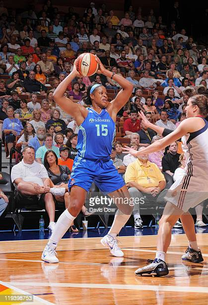 Kia Vaughn of the New York Liberty passes the basketball against Kelsey Griffin of the Connecticut Sun on July 19 2011 at the Mohegan Sun Arena in...