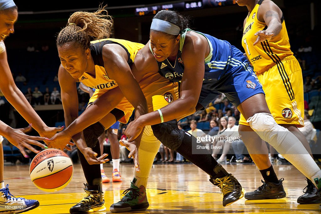 Kia Vaughn #15 of the New York Liberty reaches for a loose ball against Amber Holt #4 of the Tulsa Shock during the WNBA game on September 20, 2012 at the BOK Center in Tulsa, Oklahoma.