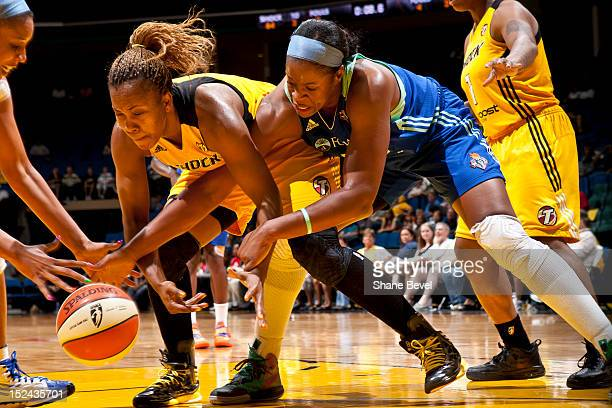 Kia Vaughn of the New York Liberty reaches for a loose ball against Amber Holt of the Tulsa Shock during the WNBA game on September 20 2012 at the...