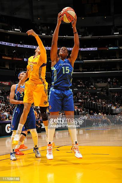 Kia Vaughn of the New York Liberty rebounds against Candace Parker of the Los Angeles Sparks at Staples Center on June 21 2011 in Los Angeles...