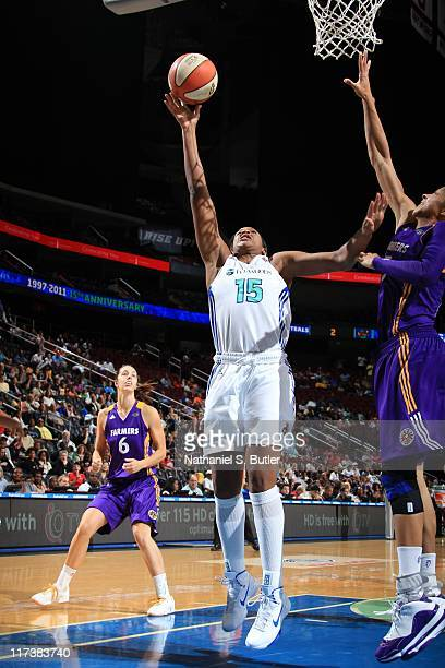 Kia Vaughn of the New York Liberty shoots against Candace Parker of the Los Angeles Sparks during a game on June 26 2011 at the Prudential Center in...
