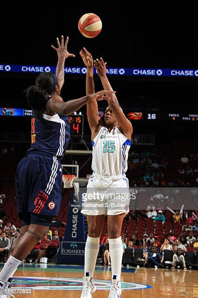 Kia Vaughn of the New York Liberty shoots against Tina Charles of the Connecticut Sun during a game on July 15 2011 at the Prudential Center in...