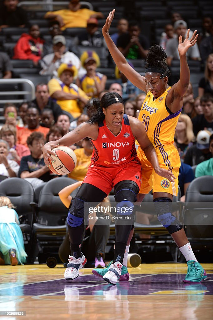 <a gi-track='captionPersonalityLinkClicked' href=/galleries/search?phrase=Kia+Vaughn&family=editorial&specificpeople=4220876 ng-click='$event.stopPropagation()'>Kia Vaughn</a> #9 of the Washington Mystics drives against the Los Angeles Sparks at STAPLES Center on July 17, 2014 in Los Angeles, California.