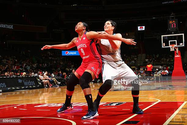 Kia Vaughn of the Washington Mystics fights for position against Janel McCarville of the Minnesota Lynx on June 11 2016 at Verizon Center in...