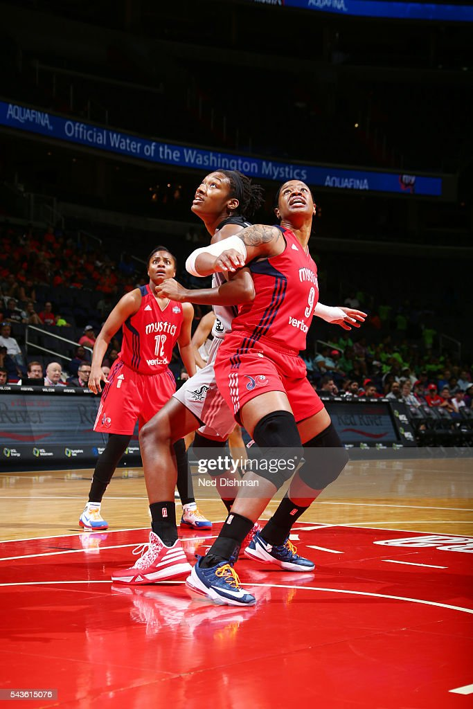 <a gi-track='captionPersonalityLinkClicked' href=/galleries/search?phrase=Kia+Vaughn&family=editorial&specificpeople=4220876 ng-click='$event.stopPropagation()'>Kia Vaughn</a> #9 of the Washington Mystics fights for position against <a gi-track='captionPersonalityLinkClicked' href=/galleries/search?phrase=Kayla+Alexander+-+Basketball+Player&family=editorial&specificpeople=10887938 ng-click='$event.stopPropagation()'>Kayla Alexander</a> #40 of the San Antonio Stars on June 29, 2016 at the Verizon Center in Washington, DC.