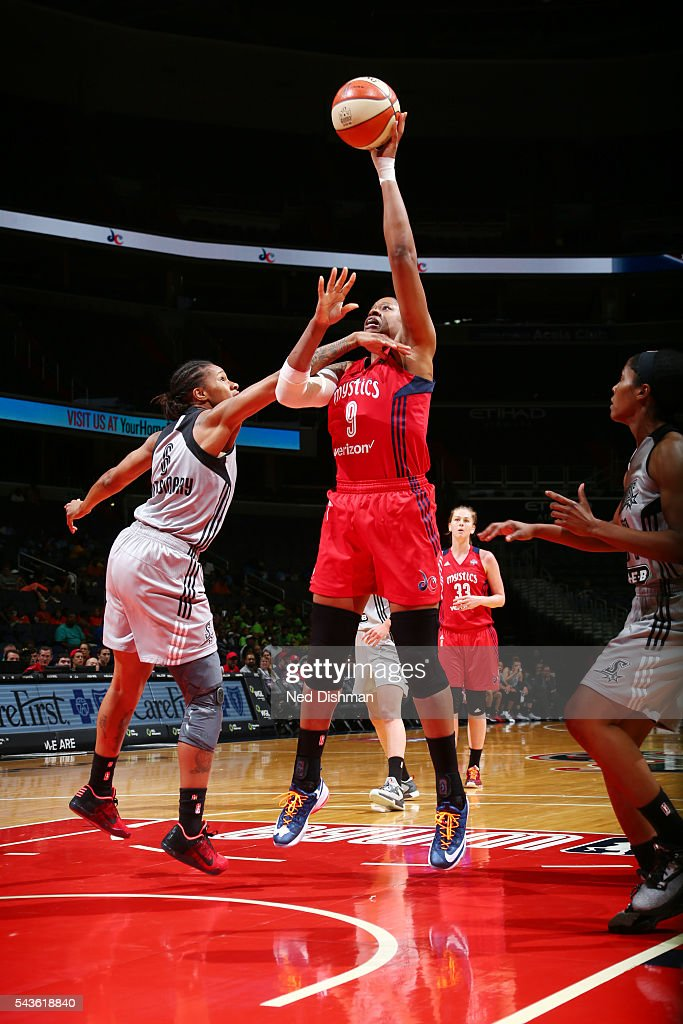 <a gi-track='captionPersonalityLinkClicked' href=/galleries/search?phrase=Kia+Vaughn&family=editorial&specificpeople=4220876 ng-click='$event.stopPropagation()'>Kia Vaughn</a> #9 of the Washington Mystics goes for a layup against the San Antonio Stars on June 29, 2016 at the Verizon Center in Washington, DC.