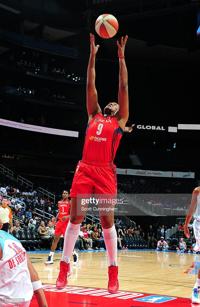 Kia Vaughn #9 of the Washington Mystics grabs a rebound against the Atlanta Dream at Philips Arena on August 28 2013 in Atlanta, Georgia.
