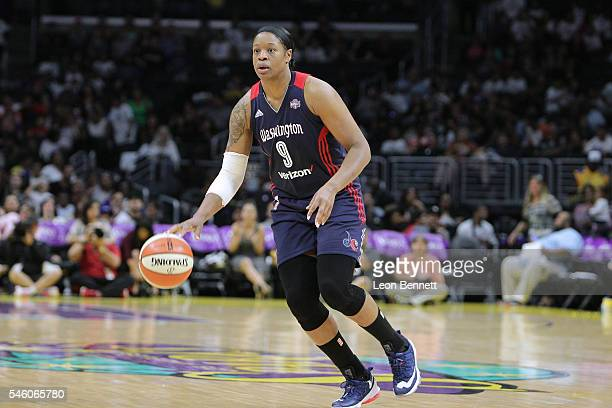 Kia Vaughn of the Washington Mystics handles the ball against the Los Angeles Sparks during WNBA basketball game at Staples Center on July 10 2016 in...