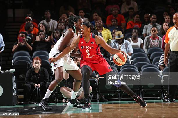 Kia Vaughn of the Washington Mystics handles the ball against the New York Liberty at Madison Square Garden on June 8 2014 in New York NY NOTE TO...
