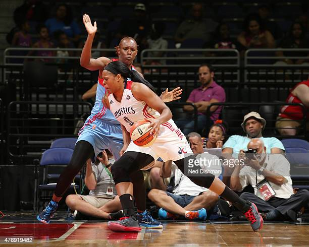 Kia Vaughn of the Washington Mystics handles the ball against the Atlanta Dream in a WNBA game at the Verizon Center on June 12 2015 in Washington DC...