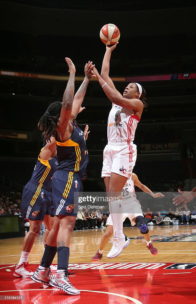 <a gi-track='captionPersonalityLinkClicked' href=/galleries/search?phrase=Kia+Vaughn&family=editorial&specificpeople=4220876 ng-click='$event.stopPropagation()'>Kia Vaughn</a> #9 of the Washington Mystics shoots against Eriana Larkins #2 of the Indiana Fever at the Verizon Center on July 21, 2013 in Washington, DC.