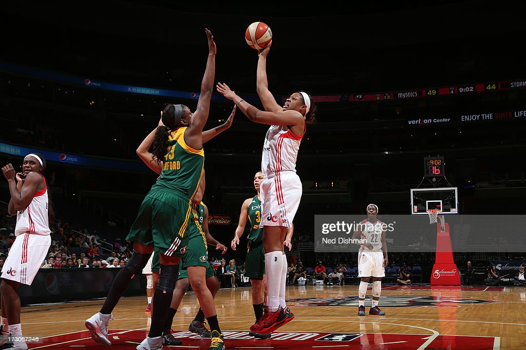 Kia Vaughn of the Washington Mystics shoots against Nakia Sanford of the Seattle Storm at the Verizon Center on July 6 2012 in Washington DC NOTE TO...